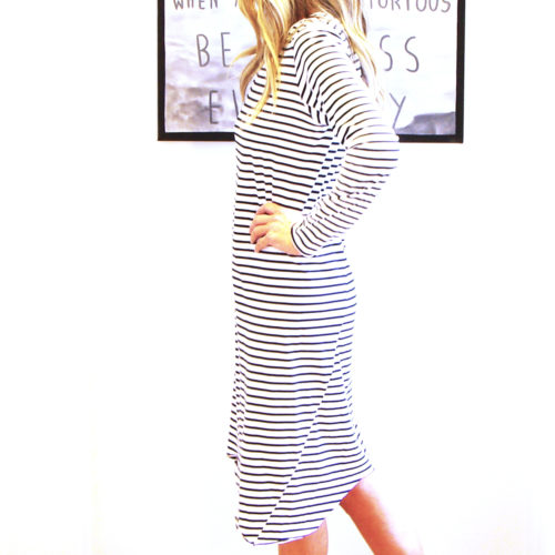Our Abi Organic Cotton Dress. Super cute and super comfy. Shown here, with long sleeves, a cut on an angled hem, and a navy and white stripe. As well as a free size, relaxed fit for ladies' 10 to 14. In short, the Abi is the ideal self-indulgent purchase to add to your wardrobe. Or as the perfect gift for someone extra special.