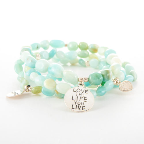 Our Aquamarine Multi-Strand Bracelet with Sterling Silver Charms is a truly beautiful gemstone piece. Shown here, with four individual strands as well as four stunning small sterling charms.