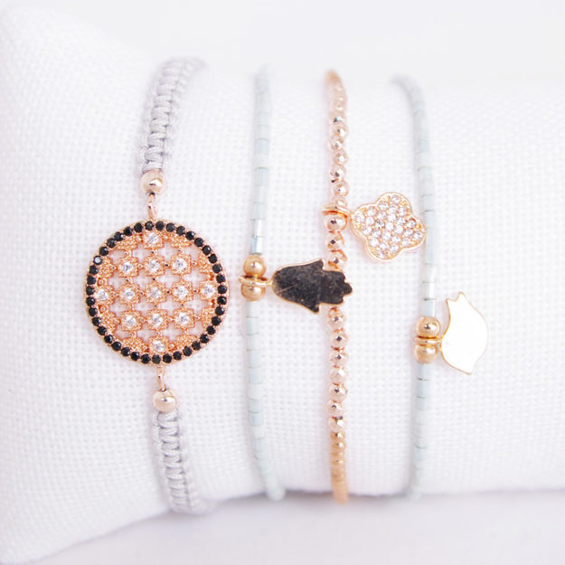 French Multi Bracelet with Pale Blue Strands & Rose Gold Plated Charms