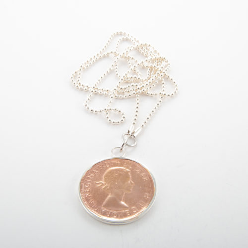 Our Sterling Silver Ball Chain with Rose Gold Two-Tone Penny. Shown here, with a rose over 925 sterling coin. In short, this unique necklace is sure to make a timeless statement. It's the ideal gift for someone special. Or the perfect self-indulgent purchase to add to your jewelry box.