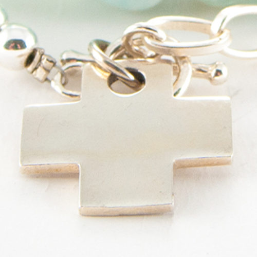 This stunning Cross Charm cast in authentic 925 Sterling Silver.