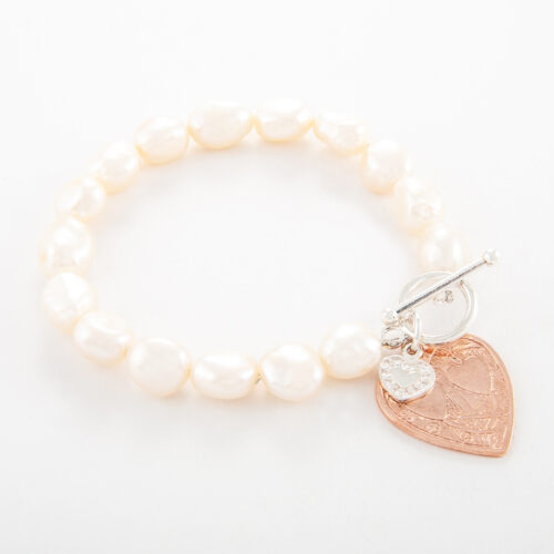 Our Freshwater Pearl Bracelet with Rose Gold Double Flat Heart. Shown here, plated over 925 sterling silver. Also with a small flat sterling heart. In short, this amazing piece has twice the love. It's the ideal addition to any personal jewellery portfolio. Or as the perfect gift idea for that extra special someone.