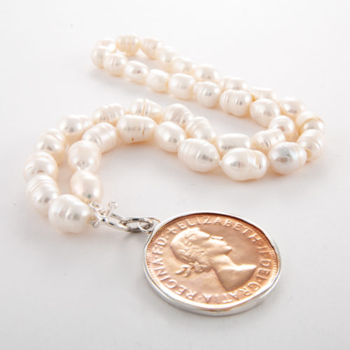 Our Freshwater Pearl Necklace with Two-Tone Penny. Shown here, with beautiful hand-made rose gold and 925 sterling silver coin. In short, this amazing piece is timeless and elegant. It's the ideal self-indulgent addition to any jewellery collection. Or as the perfect gift for someone extra special.