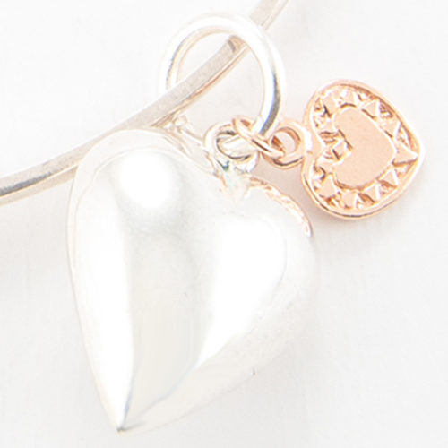 Small Puffed Heart Charm in quality 925 Sterling Silver with a small rose gold heart.