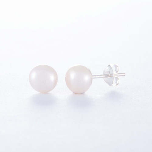 Our Freshwater Pearl Stud Earrings. Shown here, with a stunning 7mm piece, that's both beautiful and elegant. In short, this pair of little gems will make the perfect gift for someone special.