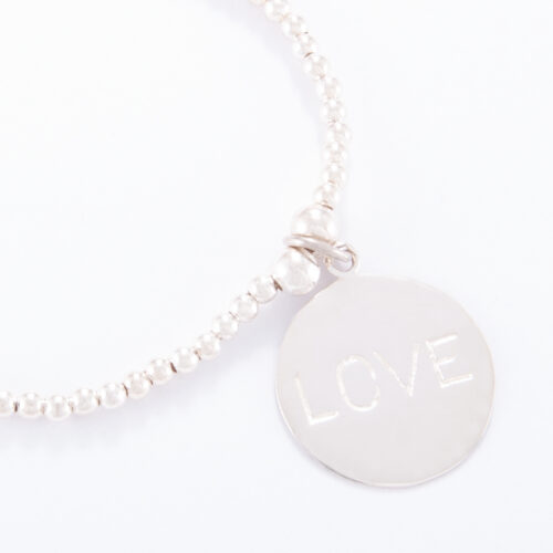 Our Sterling Silver Ball Bracelet. Shown here, with a stunning 925 sterling Large Love Disc Charm. In short, this amazing piece is full of love. It's the ideal addition to any personal jewellery portfolio. Or as the perfect gift idea for that extra special someone.