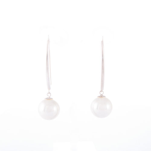 Our White Pearl Drop Earrings. Shown here, hand-made with a beautiful soft finish. In short, this pair of elegant gems are full of style. The perfect piece to complete an outfit or as the ideal gift for someone extra special.