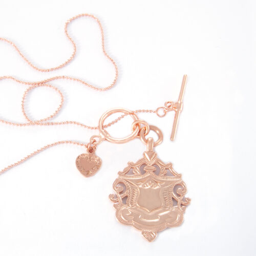 Our 16 Inch Rose Gold Fine Fob Ball Chain and Large Shield Necklace. Shown here, beautifully handcrafted. And also, engraved and plated over 925 sterling silver. In short, this piece is simply stunning. The ultimate self-indulgent addition to your jewelry collection. Or as a unique gift purchase for someone very special.
