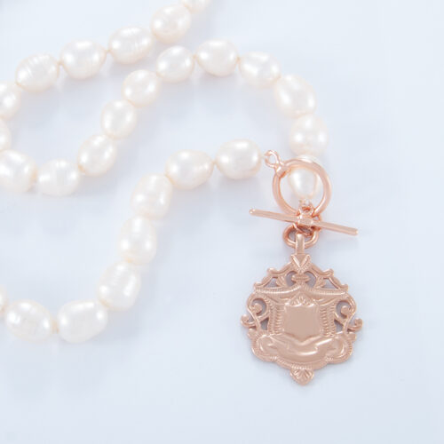 Our 18 Inch Freshwater Pearl Necklace. Shown here, with a hand-made 925 sterling silver shield. In short, this amazing substantial piece is full of style and elegance. It's the ideal self-indulgent purchase to add to your own jewelry collection. Or as a gift for someone very, very special.
