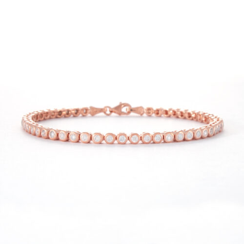 "Our 2mm Rose Gold Cubic Zirconia Tennis Bracelet. Shown here, plated over 925 sterling. And, also multiple sparkling round CZ. In short, it's ""Game Set and Match""! With this amazing classic piece. The perfect gift for someone extra special. Or as a self-indulgent addition to your personal jewellery collection."