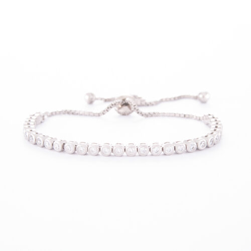 Our 2mm Sterling Silver Cubic Zirconia Adjustable Tennis Bracelet. Shown here, finished in 925 sterling. With multiple round sparkling CZ. In short, this piece is classic, as well as timeless. The perfect gift idea for that someone extra special. Or as a self-indulgent addition to your own jewellery collection.