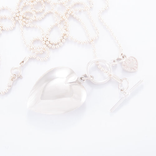 Our 70cm Sterling Silver Ball Chain Necklace. Shown here, with large puffed heart & small flat heart. Also, beautifully hand-crafted in 925 sterling. In short, this stunning piece is elegant and full of style. The perfect gift for someone extra special. Or as a self-indulgent addition to your own personal jewelry collection.