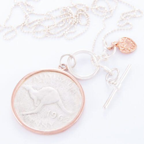 Our Long Fine Sterling Silver Ball Chain Fob Large 2-Tone Australian Charm Penny Necklace. Shown here, hand-made in 925 sterling. Also, accompanied by a small rose gold plated heart and coin surround. In short, this beautiful piece is timeless and full of style. The ideal self-indulgent addition to any personal jewelry collection. Or as a gift for someone extra special.