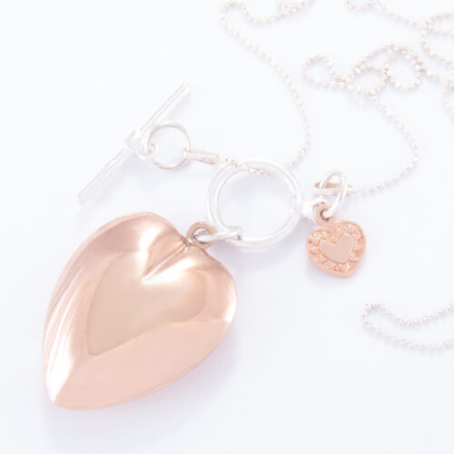Our Long Fine Sterling Silver Fob Ball Chain Fob Necklace. Shown here with a hand-made large puffed heart and small flat heart. Also Plated over 925 sterling. In short, this piece is simply stunning. The perfect gift idea for someone extra special. Or as a self-indulgent addition to any personal jewelry collection.
