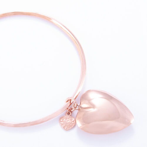 Our Rose Gold Large Puffed Heart Bangle. Shown here, plated over hand-made 925 sterling with a large puffed heart. As well as, with a small heart. It's a truly unique and stunning piece. In short, the ideal gift idea, with double the love. Or as a self-indulgent addition to your own jewelry collection.