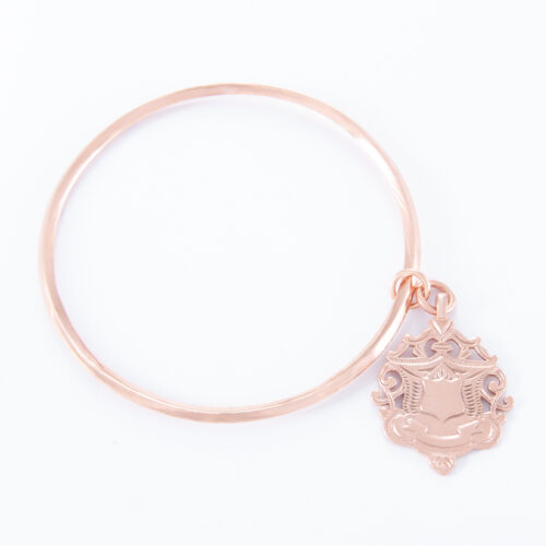 Our Rose Gold Large Shield Bangle. Shown here, plated in pink gold over a 925 sterling silver large shield. It's a truly unique and stunning piece. In short, the ideal gift idea for someone extra special. Or as a self-indulgent purchase to add to your own personal jewelry collection.