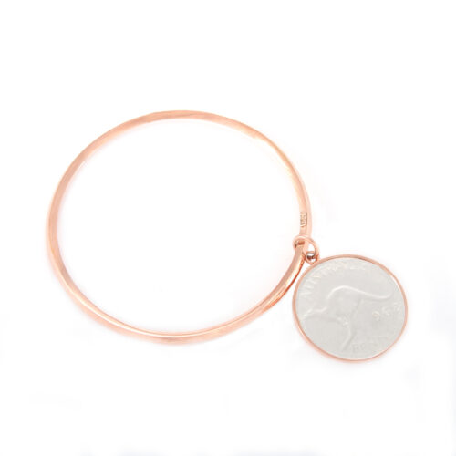 Our Rose Gold Penny Bangle. Shown here, with a bevilled edge, plated over hand-made 925 sterling silver. As well as, with a beautifully finished 2-tone coin. It's a truly stunning and unique piece. In short, the ideal gift for someone special. Or as a self-indulgent addition to any personal jewelry collection.