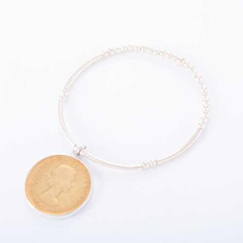 Our Sterling Silver Ball Bar 2 Tone Half Penny Bracelet. Shown here, in hand-made 925 sterling with a gold plated coin as well as a sterling rim. In short, this beautiful piece is timeless. The perfect self-indulgent addition to any personal jewelry collection. Or as the ideal gift for someone special.