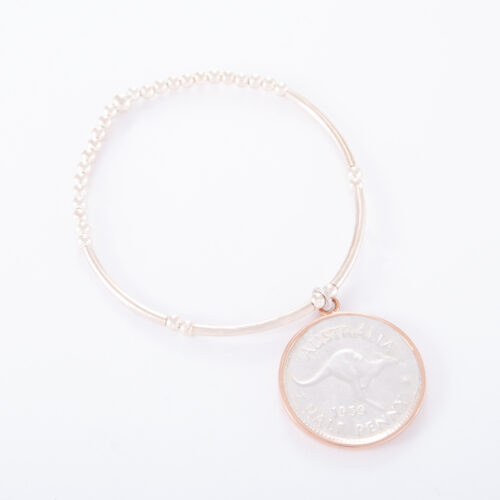 Our Sterling Silver Ball Bar Bracelet with 2 Tone Half Penny. Shown here, with a stunning hand-made 925 sterling coin. As well as a plated rose gold rim. In short, this amazing piece is elegant, yet timeless. It's the ideal self-indulgent addition to any personal jewellery collection. Or as the perfect gift idea for someone special.