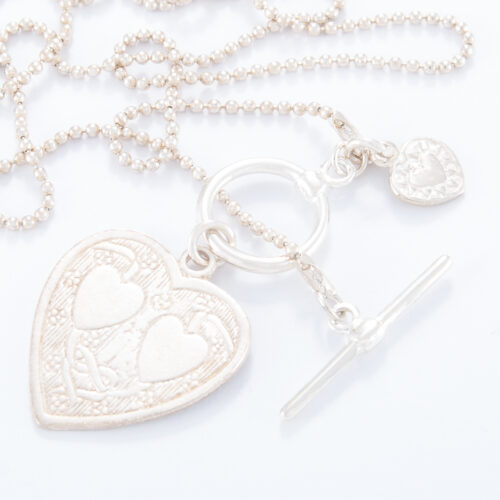 Our Sterling Silver Ball Chain Fob Double Heart Charm Necklace. Shown here, hand-made 925 sterling. And also engraved with two hearts on a stunning sterling large flat heart. As well as a small heart. In short, this piece is simply beautiful, with twice the love. The perfect self-indulgent addition to any personal jewelry collection. Or as a gift for somebody very, very special.