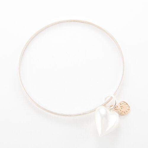 Our Sterling Silver Double Heart Bangle. Shown here, in hand-made 925 sterling with a large puffed heart. As well as, with a small heart in rose gold. Is a truly stunning and unique piece. In short, it makes for the ideal gift idea, with lots of love. Or as a self-indulgent addition to any personal jewelry collection.