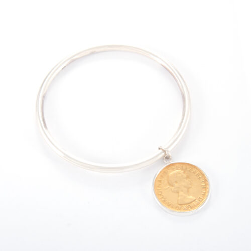 Our Sterling Silver Half Penny Tube Bangle. Shown here, in hand-made 925 sterling. As well as, with a 2-tone gold plated coin. A truly beautiful and unique piece. In short, it makes for the ideal gift for somebody special. Or as a self-indulgent addition to any jewelry collection.
