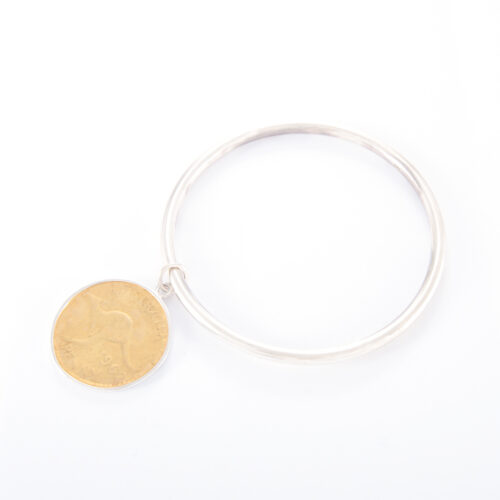 Our Sterling Silver Tube Penny Bangle. Shown here, in hand-made 925 sterling. As well as, a stunning 2-tone gold plated coin. A truly unique and beautiful piece. In short, it's the ideal self-indulgent addition to any personal jewelry collection. Or as a gift for someone special.
