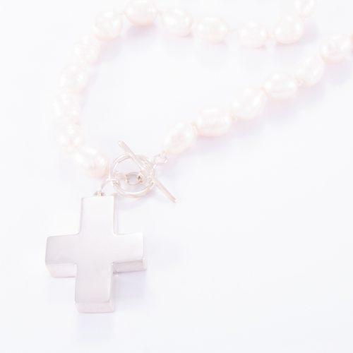 Our Freshwater Pearl Fob Cross Necklace. Shown here, with a large hand-made 925 sterling silver cross. In short, this amazing substantial piece is full of elegance and style. And is sure to make a statement. It's the perfect self-indulgent addition to your own jewellery collection. Or as the ideal gift for someone very, very special.
