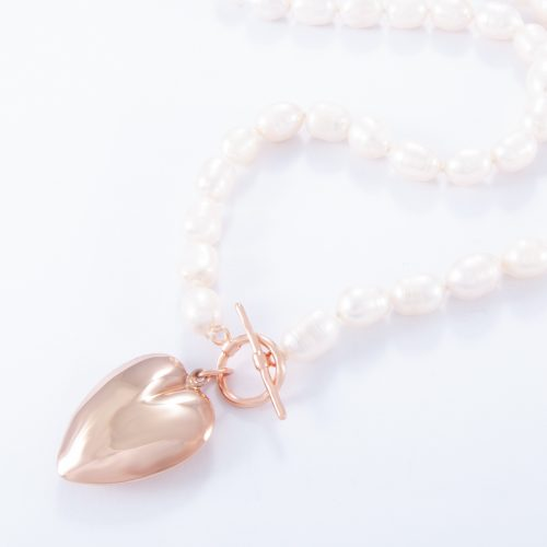 Our Freshwater Pearl Large Rose Gold Puffed Heart Necklace. Shown here, with a handcrafted pink gold over 925 sterling charm. In short, this beautiful substantial piece is full of love, elegance and style. It's the ideal self-indulgent purchase to add to your own jewellery collection. Or as the perfect gift for somebody extra special.