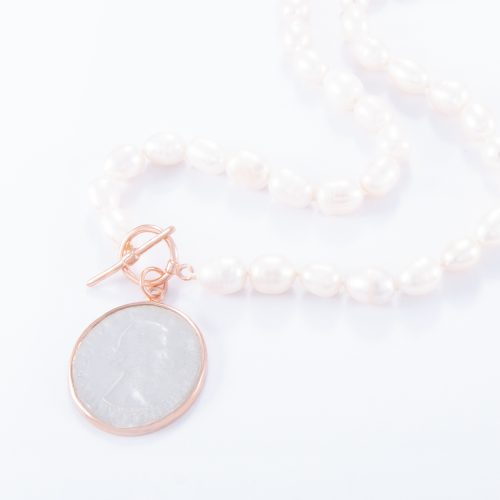 Our Freshwater Pearl Rose Gold Large Penny Necklace. Shown here, with a lovely 2-tone coin charm. Handcrafted in pink gold over 925 sterling silver. In short, this is a beautiful timeless piece, hand-made with lots of love. It's the ideal self-indulgent purchase to add to your personal jewellery collection. Or as the ultimates surprise gift for her.