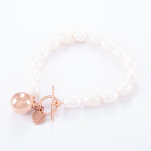 Our Freshwater Pearl Rose Gold Love Heart Ball Bracelet. Shown here, with a beautiful pink gold flat heart and ball charm. Both plated over 925 sterling silver. In short, this amazing piece has double the fun. It's the ideal self-indulgent addition to any personal jewellery collection. Or as the perfect gift for her on that extra special occasion.