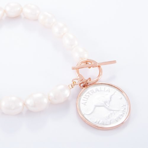 Our Freshwater Pearl Rose Gold Small Coin Bracelet. Shown here, with a lovely 2-tone half penny. Handcrafted in pink gold over 925 sterling silver. In short, this is a stunning timeless piece, made with love. It's the perfect self-indulgent addition to any personal jewellery collection. Or as the ultimate gift for that extra special someone.