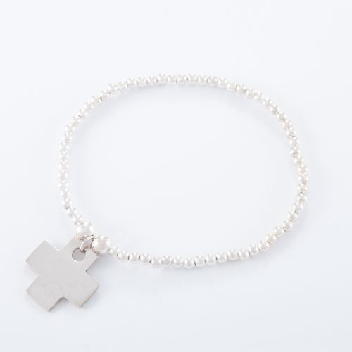 Our Sterling Silver Flat Cross Ball Bracelet. Shown here, with a stunning 925 sterling charm. In short, this amazing piece is sure to bring a big smile. It's the ideal self indulgent purchase to add to your own jewellery portfolio. Or as the perfect gift idea for that someone extra special.