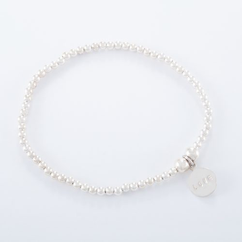 Our Sterling Silver Small Love Disc Ball Bracelet. Shown here, with a stunning 925 sterling charm stamped with LOVE. In short, this is a beautiful piece that's sure to hit the mark. The ideal self indulgent purchase to add to your own jewellery collection. Or as the perfect gift for somebody extra special.