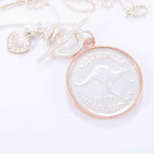 Our Fine Sterling Silver Fob Necklace and 2 Tone Half Penny. Shown here, with a beautiful 2 tone coin, hand-made in 925 sterling. Also, matched with a small flat sterling heart and rose gold over sterling coin surround. In short, this stunning statement piece is timeless, full of love, and full of style. The ideal self-indulgent purchase to add to any personal jewellery collection. Or as the perfect gift for that someone extra special.