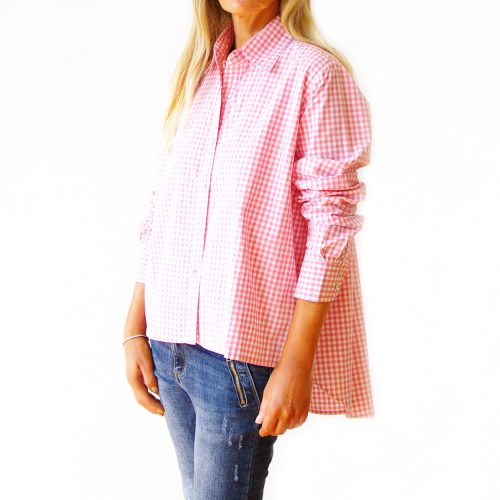 Our Ginger Pale Pink Gingham Shirt. Shown here with an easy button up, front and relaxed wide collar. As well as a smart double button cuff and scooped hem at the back. Furthermore, Ginger offers an oversized fit best suited to a ladies' size 10 to 16. In short, it's the ideal self-indulgent purchase this spring to add to your wardrobe or as a summer gift for someone extra special.