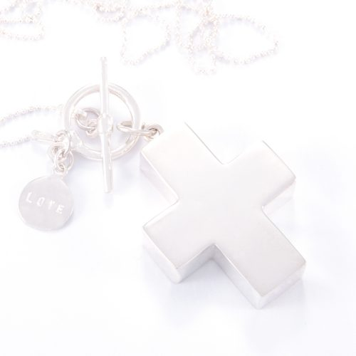 Our Long Fine Sterling Silver Fob Cross Necklace. Shown here, beautifully hand-made in 925 sterling. As well as being paired with a stamped sterling LOVE disc. In short, this sunning piece is sure to make a statement. The perfect self-indulgent purchase to add to your own jewellery collection. Or the ideal gift for someone extra special.