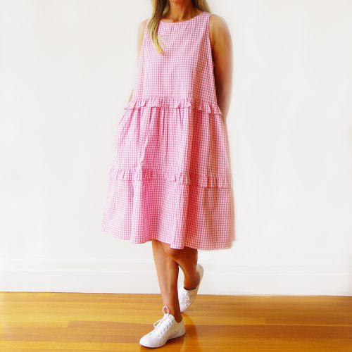 Our Rosie Sleeveless Pale Pink & White Gingham Dress. Is an absolute stunner. Shown here, with an airy full skirt and comfy side pockets. As well as a gorgeous frill detailing. Furthermore, our stunning Rosie offers a free size relaxed fit for ladies' 10 to 16. In short, it's the perfect self-indulgent purchase to add to this summers wardrobe or as a gift for someone extra special.
