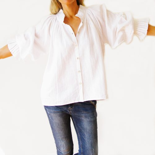 Our Sammi White Linen Shirt. Shown here in 100 percent pure linen. Also, with a smart button up front and oversized puffy sleeve. As well as gorgeous detailing, in the collar and sleeves. Furthermore, our stunning Sammi offers a free size relaxed fit for ladies' 10 to 16. In short, it's the perfect self-indulgent purchase to add to this springs wardrobe or as a summer gift for someone special.