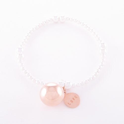 Our Two-Tone Sterling Silver Rose Gold Love Ball Bracelet. Shown here, with a stunning pink gold over 14mm 925 sterling ball charm. As well as a stamped rose over sterling LOVE disc. In short, this is a beautiful piece that's sure to hit the mark. The ideal self-indulgent purchase to add to your jewellery collection. Or as the perfect gift for someone extra special.