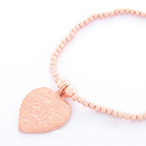 Our Rose Gold Small Tiamo Heart Ball Bracelet. Shown here, beautifully engraved and handcrafted in pink gold over 925 sterling. There's twice the love in this elegant, stunning piece. In short, it's the perfect self-indulgent purchase to add to your own personal jewelry collection. Or as a unique gift idea for that someone very special.