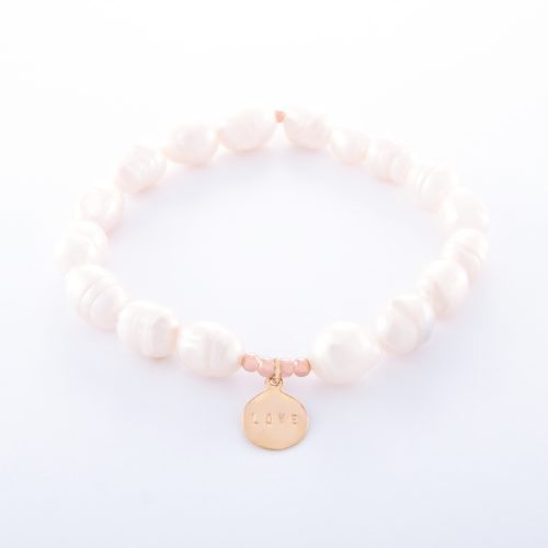 Our Freshwater Pearl Bracelet with Rose Gold Love Disc. Shown here with beautifully engraved pink gold plating over 925 sterling. In short, this stunning piece is elegant and full of love. It's the ideal gift for someone extra special. Or, as the perfect self-indulgent purchase to add to your own jewelry collection.
