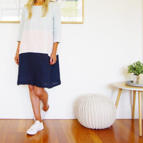 Our Piper Sky Blush Navy Linen Dress. Shown here, in 100% pure linen, comes in 5 fabulous colour combinations. All using a beautiful sky blue, blush pink, navy, and mocha fabric. Furthermore, this dress features a slight A-line design, rounded neck, 3 quarter sleeve button detail, and comfy side pockets. Also, handcrafted in 2 sizes. An S/M suited to ladies 10-12 and an M/L for ladies 14-16. It's the perfect gift idea for someone very special or as the ideal must-have addition to your own wardrobe.
