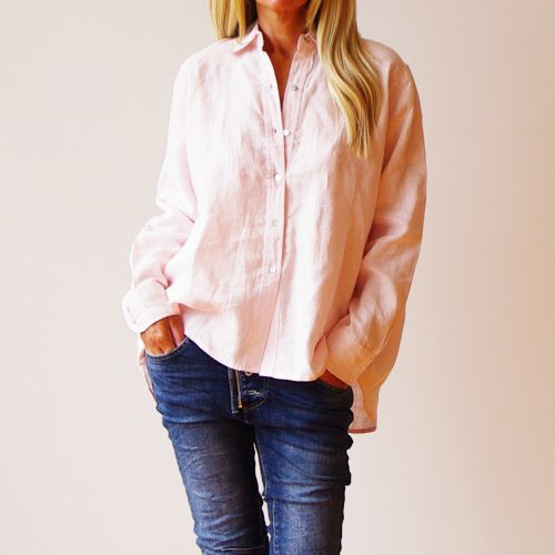 Our Murphy Pale Pink Linen Shirt. Shown here, handcrafted in 100% pure linen. Beautifully styled, with a relaxed wide collar and easy button-up front. As well as, a smart double button cuff, pleated back, and scooped hem at the back. And, a cute red embroidered kiss hug kiss (xox) back collar detail. Four fabulous colors, a classic navy, blush pink, sky blue, and white. Murphy offers 2 sizes. An S/M suited to ladies 10-12 and an M/L for ladies 14-16. In short, it's an ideal gift for someone special. Or as the perfect self-indulgent purchase to add to your own wardrobe.