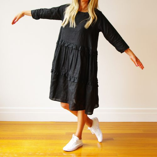 Our Rosie Long Sleeve Black Linen Dress. Is an absolute stunner. Shown here, in 100% pure linen. With an airy full skirt, comfy side pockets, and a flexible three-quarter button-up sleeve. As well as, gorgeous frill detailing. Rosie offers a free-size relaxed fit in two sizes. An S/M for ladies' 10 to 12 and M/L for sizes 14 to 16. Available in four fab colors. A beautiful black, stunning sky blue, blush pink and classic navy. In short, it's the perfect self-indulgent addition to your own wardrobe. Or as a gift for someone special