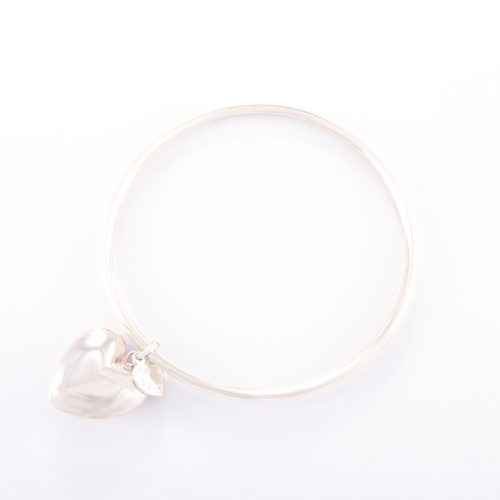 Our Sterling Silver Bangle and Puffed Heart. Shown here, hand-made in a 925 sterling bevel-edged band, with a large puffed heart. As well as, with a small heart in sterling. In short, it's a truly stunning and unique piece. Which makes for the ideal gift idea, with lots of love. Or as a self-indulgent purchase to add to any accessories collection.
