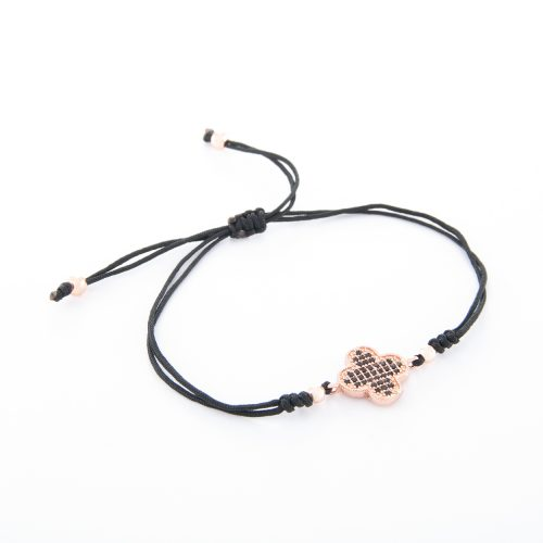 Our Boho Adjustable Bracelet with Rose Gold and Jet Bead Clover. Shown here, with adjustable black strands and beautiful pink gold plating. This piece is full of lots of luck. In short, it's the perfect gift for someone special. Or as a self-indulgent purchase to add to your personal jewelry collection.