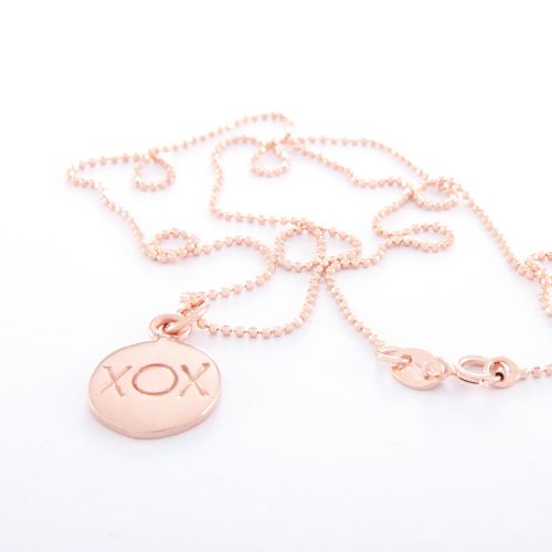 Our Rose Gold Ball Chain Necklace and Kiss Hug Kiss Disc. Shown here, handcrafted beautifully in a pink gold over 925 sterling finish. As well as with a stamped charm. In short, this relaxed piece is a lot of fun. The perfect self-indulgent addition to your jewelry collection. Or as a unique gift idea purchase for someone extra special.