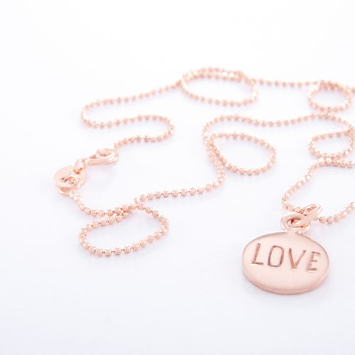 Our Rose Gold Ball Chain Necklace and Love Disc. Shown here, handcrafted beautifully in pink gold over 925 sterling. As well as with a stamped charm. In short, this little piece is absolutely stunning. The ideal self-indulgent addition to any personal jewelry collection. Or as the perfect gift idea, for that extra special someone.