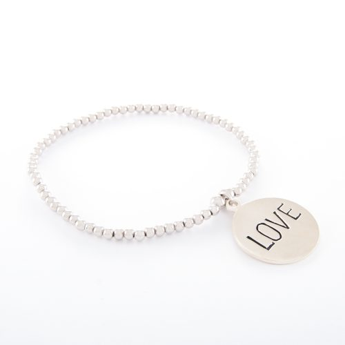 """Our Sterling Silver Ball Bracelet and Large Love Disc. Shown here, handcrafted with a stunning stamped, 925 sterling charm. In short, this beautiful piece is full of """"LOVE"""" and elegance. It's the perfect self -indulgent purchase to add to your own jewelry collection. Or as the ideal gift idea for someone extra special."""